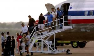 Passengers get off an American Airlines plane that made an emergency landing at Meacham Field (Fort Worth Star-Telegram/Khampha Bouaphanh)