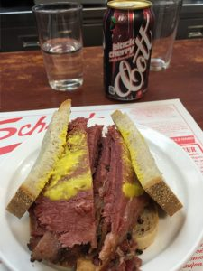 Montreal Smoked Meat Sandwich and black cherry soda from Schwartz's Deli