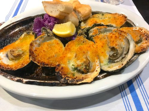 Oysters charbroiled with butter, garlic and pecorino cheese