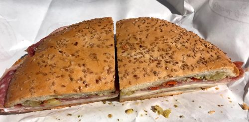 Muffuletta sandwich with Italian meats, cheeses and olive spread on Sicilian bread from Central Grocery in New Orleans