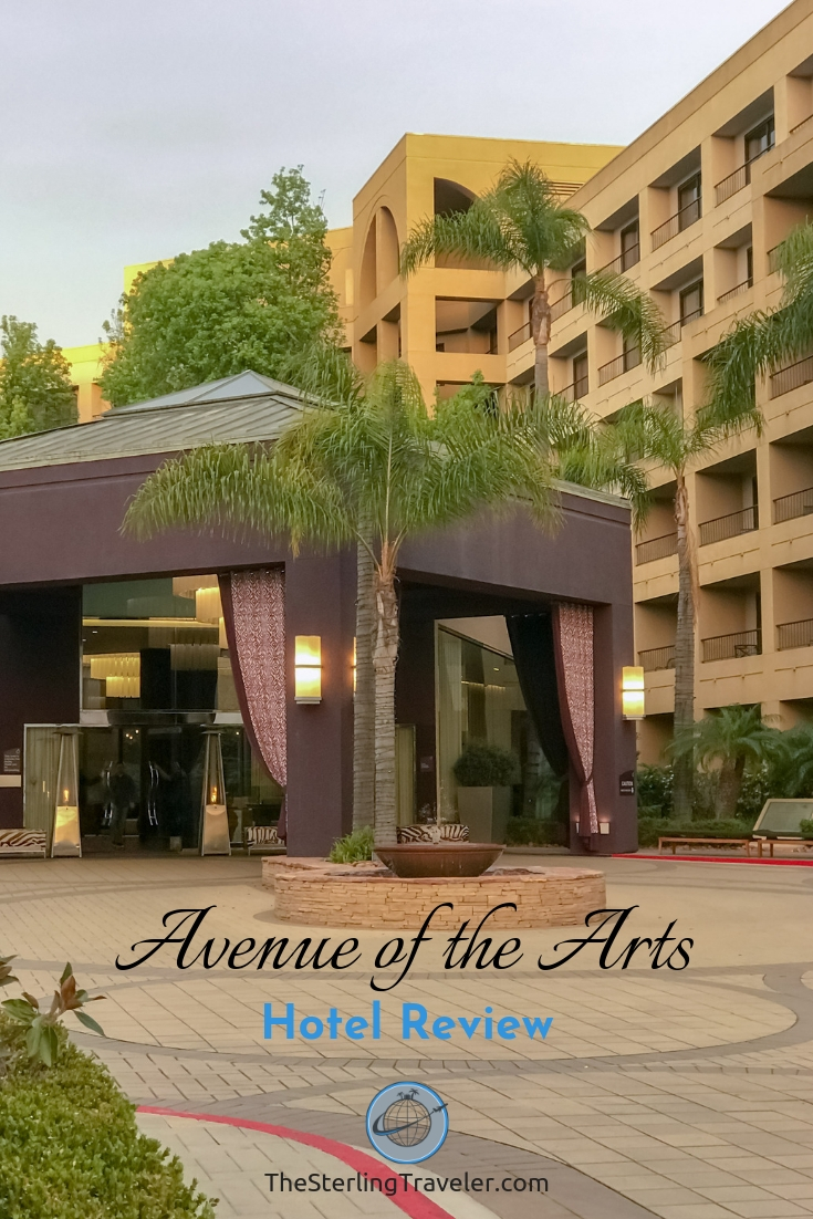 Front Entrance to the Avenue of the Arts hotel, in Costa Mesa. Valet parking area and palm trees in front with hotel behind it.