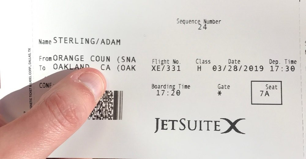 Boarding pass for JetSuiteX flight on card stock
