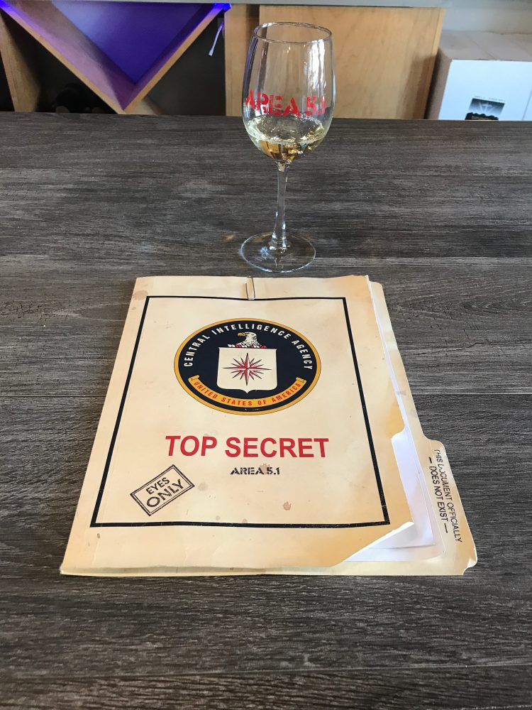 Manila folder with Top Secret written on the front. The contents contain the list of wines that are offered for tastings.